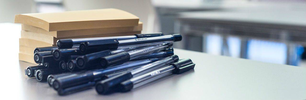 stack of notepads and pens